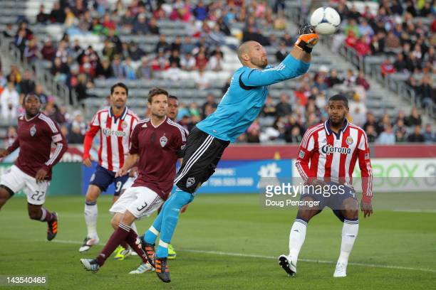 Goalkeeper Matt Pickens of the Colorado Rapids turns the ball away against Chivas USA at Dick's Sporting Goods Park on April 28 2012 in Commerce City...