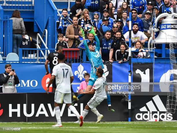 Goalkeeper Matt Turner of the New England Revolution jumps for the ball against the Montreal Impact during the MLS game at Saputo Stadium on May 18...