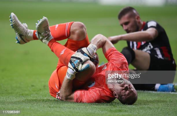Goalkeeper Matz Sels of Strasbourg reacts after a tackle from Ante Rebic of Frankfurt during the second leg of the UEFA Europa League playoff match...