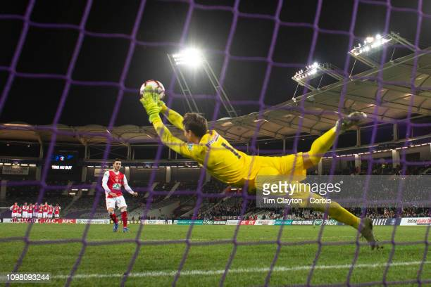 Goalkeeper Mauro Goicoechea of Toulouse makes a decisive save from the penalty of Xavier Chavalerin of Stade De Reims during the penalty shoot to...