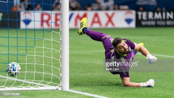 Goalkeeper Maxime Crepeau of the Vancouver Whitecaps watches the ball hit the back of his net after failing to stop the shot of Alan Pulido of...