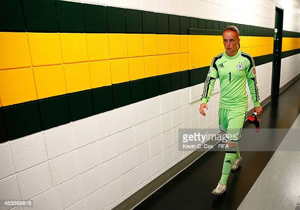 Goalkeeper Meike Kaemper of Germany walks down the hallway to the pitch prior to facing China PR at Commonwealth Stadium on August 8 2014 in Edmonton...