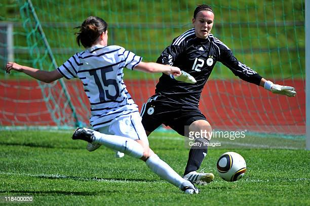 Goalkeeper Merle Frohms of Germany and Laura Douessin of France battle for the ball during the Women Nordic Cup match between Germany and France on...