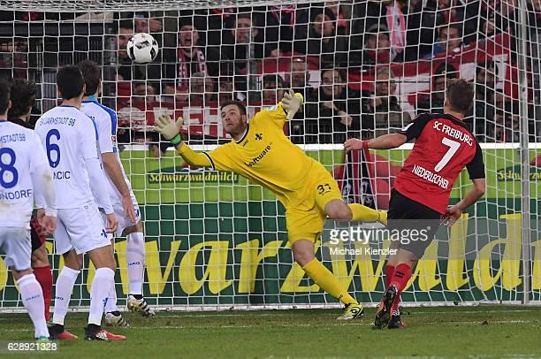 Goalkeeper Michael Esser of SV Darmstadt 98 saves Florian Niederlechner of SC Freiburg hit on goal during the Bundesliga match between Sport Club...