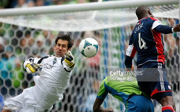 Goalkeeper Michael Gspurning of the Seattle Sounders FC blocks a corner kick shot against the New England Revolution at CenturyLink Field on April 13...