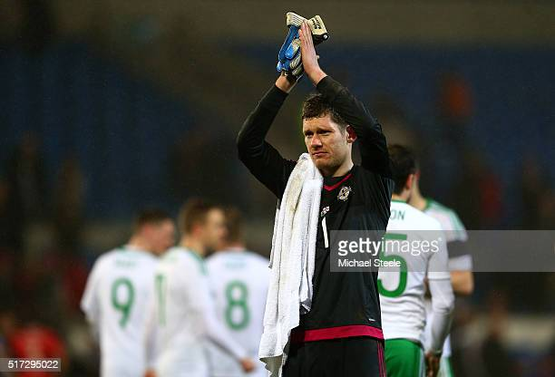 Goalkeeper Michael McGovern of Northern Ireland applauds the fans following the 1-1 draw during the international friendly match between Wales and...