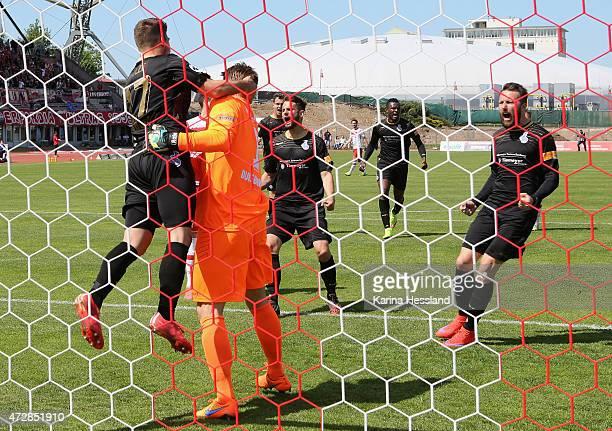 Goalkeeper Michael Ratajczak of Duisburg celebrates with teammates after Penalty Kick by Carsten Kammlott of Erfurt during the Third League match...
