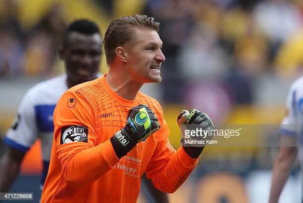 Goalkeeper Michael Ratajczak of Duisburg shows his delight after winning the third league match between SG Dynamo Dresden and MSV Duisburg at...
