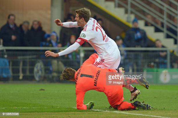 Goalkeeper Michael Ratajczak of Paderborn and Thomas Mueller of Bayern Muenchen in action during the DFB Cup match between SC Paderborn and Bayern...