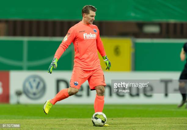 Goalkeeper Michael Ratajczak of Paderborn controls the ball during the DFB Cup match between SC Paderborn and Bayern Muenchen at Benteler Arena on...