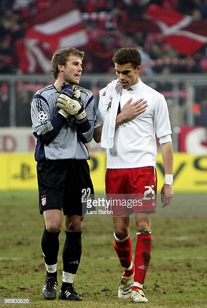 Goalkeeper Michael Rensing discuses with Valerien Ismael after the UEFA Champions League Round of 16 First Leg match between Bayern Munich and AC...
