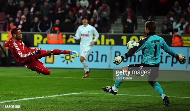 Goalkeeper Michael Rensing of Koeln saves a shoot of Dennis Aogo of Hamburg during the Bundesliga match between 1 FC Koeln and Hamburger SV at...