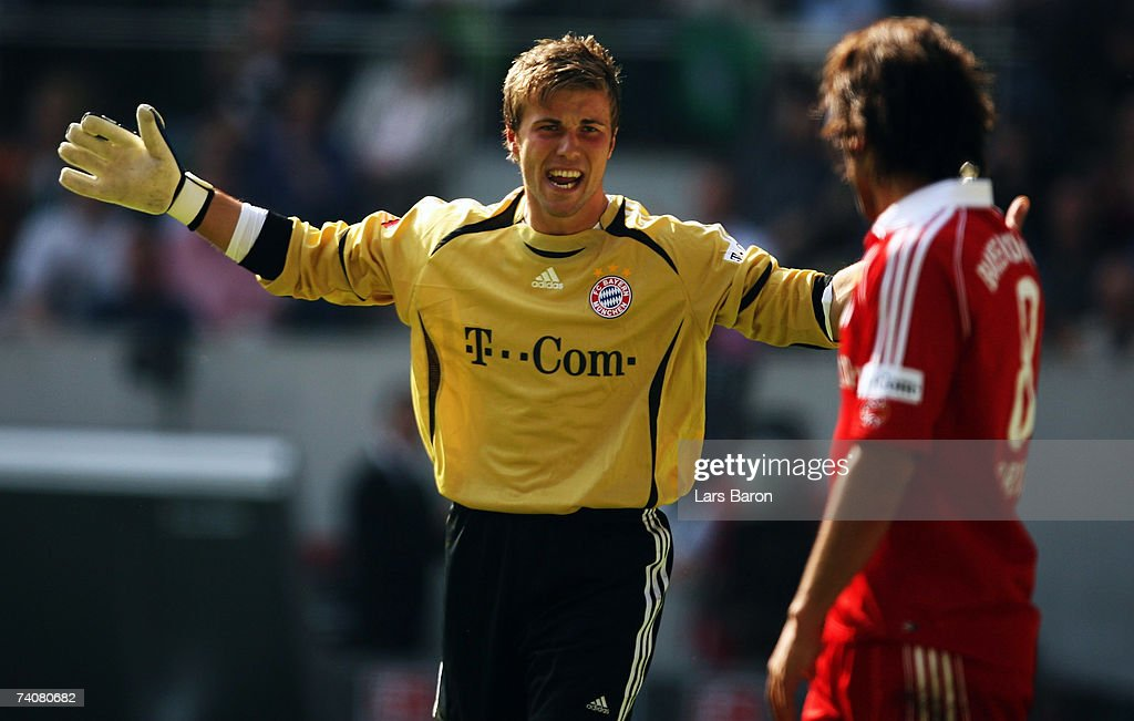 Goalkeeper Michael Rensing of Munich gestures to Ali Karimi during the Bundesliga match between Borussia Monchengladbach and Bayern Munich at the Borussia Park on May 5, 2007 in Monchengladbach, Germany.