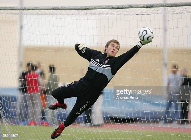 Goalkeeper Michael Rensing reacts to save a ball during a Bayern Munich training session at the club's training camp on January 9 2006 in Dubai...