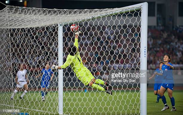 Goalkeeper Miho Fukumoto of Japan can't save a shot by Heatherr O'Reilly of the United States on Monday August 18 in the Games of the XXIX Olympiad...