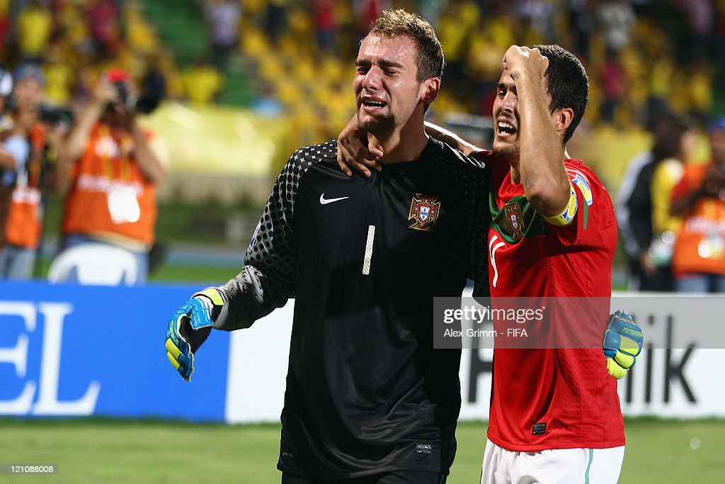 Goalkeeper Mika (L) and Nuno Reis of Portugal celebrate after the penalty shoot-out at the FIFA U-20 World Cup 2011 quarter final match between Portugal and Argentina at Estadia Jaime Moron Leon on August 13, 2011 in Cartagena, Colombia.