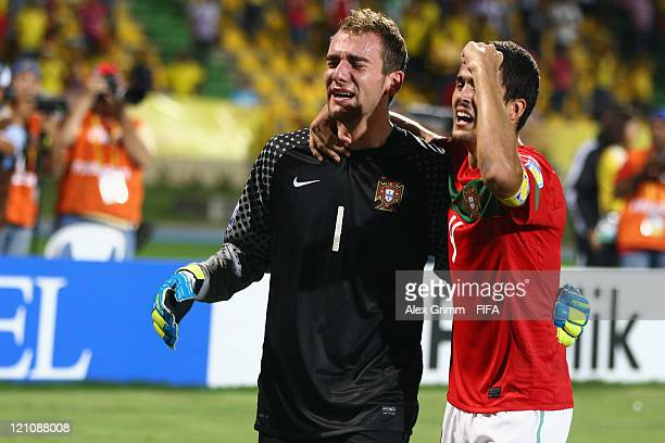 Goalkeeper Mika and Nuno Reis of Portugal celebrate after the penalty shootout at the FIFA U20 World Cup 2011 quarter final match between Portugal...