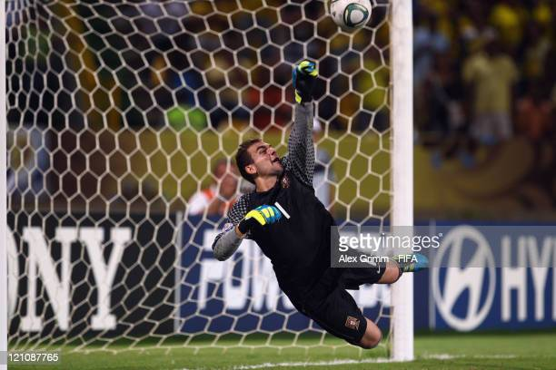 Goalkeeper Mika of Portugal kills the deciding penalty during the penalty shootout at the FIFA U20 World Cup 2011 quarter final match between...