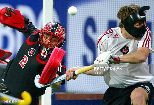 Goalkeeper Mike Mahood of Canada blocks a shot as his teammate Paul Wettlaufer defends during a Hockey World Cup Qualifier Pool A match against...