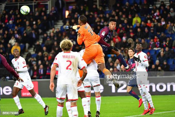 Goalkeeper Mike Maignan of Lille punches clear under pressure from Kimpembe Presnel of PSG during the Ligue 1 match between Paris Saint Germain and...
