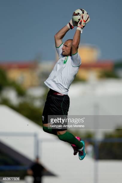 Goalkeeper Mikel Saizar of Cordoba CF stops the ball during his warming up prior to start the friendly football match between Marbella FC and Cordoba...