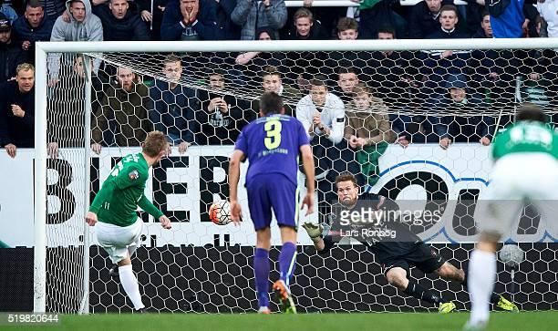 Goalkeeper Mikkel Andersen of FC Midtjylland saves the penalty from Sebastian Andersen of Viborg FF during the Danish Alka Superliga match between...