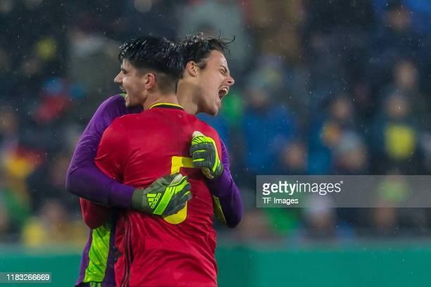goalkeeper Mile Svilar of Belgium U21 and Thibault De Smet of Belgium U21 gestures during the UEFA Under 21 European Qualifier match between Germany...