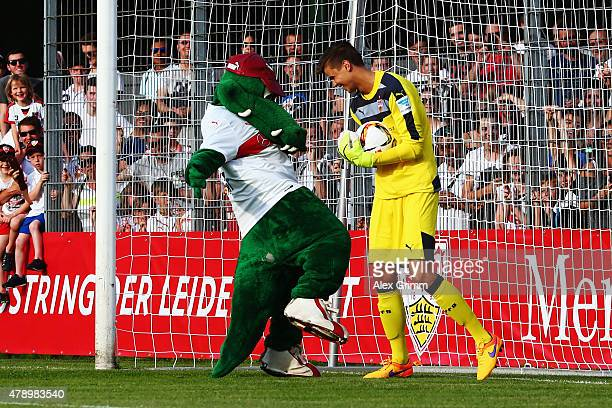 Goalkeeper Mitch Langerak and mascot Fritzle during the first training session of VfB Stuttgart at Robert-Schlienz-Stadion on June 29, 2015 in...