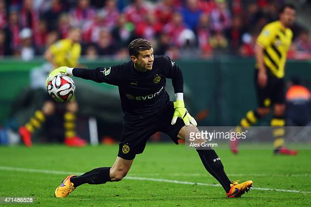 Goalkeeper Mitch Langerak of Dortmund throws the ball during the DFB Cup Semi Final match between FC Bayern Muenchen and Borussia Dortmund at Allianz...