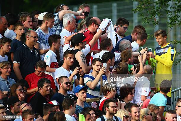 Goalkeeper Mitch Langerak signs autographs after the first training session of VfB Stuttgart at Robert-Schlienz-Stadion on June 29, 2015 in...