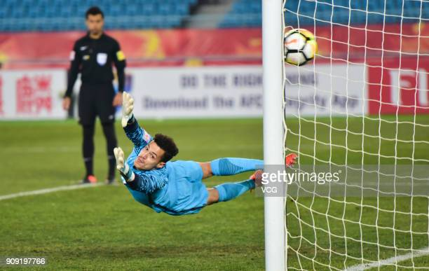 Goalkeeper Mohammed Al Bakari of Qatar fails to save a penalty kick during the AFC U23 Championship semifinal match between Qatar and Vietnam at...