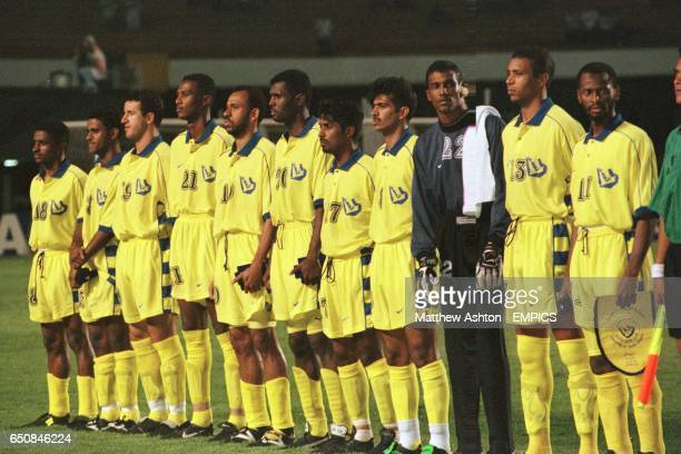 Goalkeeper Mohammed Babkr and captain Muhaisen Al Dosari of Al Nassr take a look at their opponents Corinthians during the national anthems