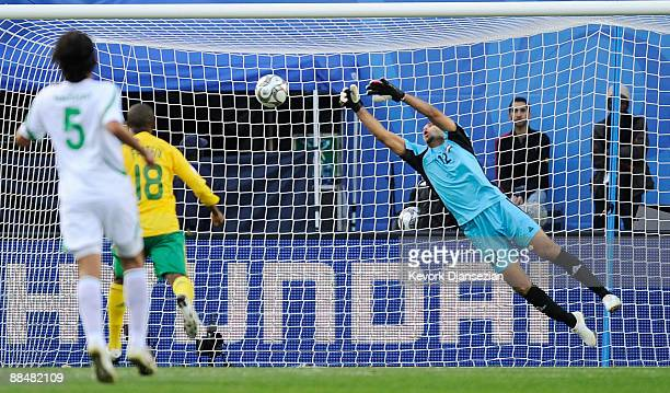 Goalkeeper Mohammed Kassid of Iraq blocks a shot on goal by of South Africa takes a shot on goal as looks on during the first half of the opening...