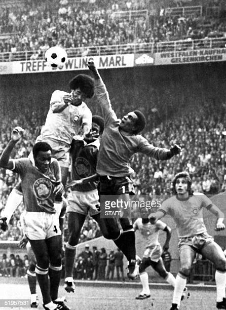 Goalkeeper Muamba Kazadi from Zaire punches the ball away from Brazilian forward Janrzinho 22 June 1974 in Gelsenkirchen during the World Cup first...