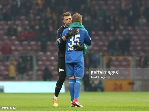 Goalkeeper Muslera of Galatasaray hugs Goalkeeper Patrik Carlgren of Atiker Konyaspor at the end of the Turkish Ziraat Cup Quarter Final second leg...