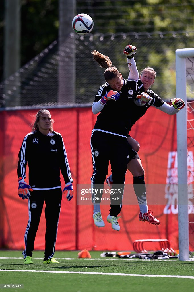 Goalkeeper Nadine Angerer, Almuth Schult and Laura Benkarth of Germany practice during a morning training session at Algonquin College Soccer Complex on June 3, 2015 in Ottawa, Canada.
