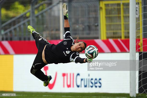 Goalkeeper Nadine Angerer makes a save during a Germany training session at CarlBenzStadion on April 9 2014 in Mannheim Germany