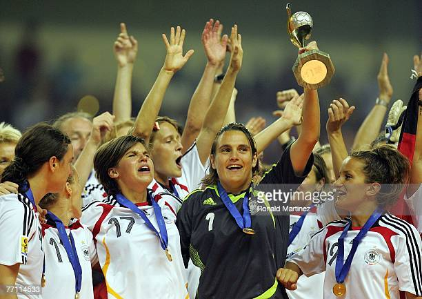 Goalkeeper Nadine Angerer of Germany raises the FIFA Women's World Cup 2007 trophy after defeating Brazil 20 at Shanghai Hongkou Football Stadium on...