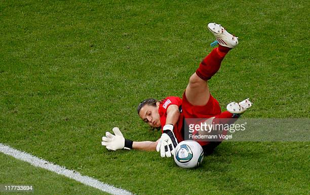 Goalkeeper Nadine Angerer of Germany saves the ball during the FIFA Women's World Cup 2011 Group A match between Germany and Nigeria at FIFA World...