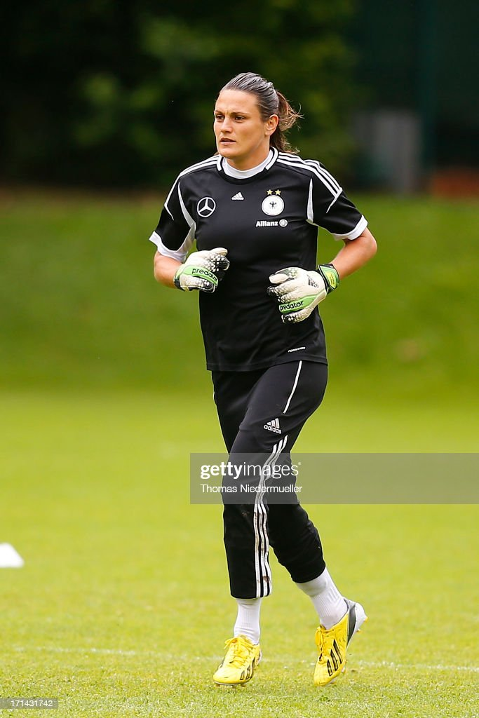 Goalkeeper Nadine Angerer runs during the German women's national team training session at HVB Club Sportzentrum on June 24, 2013 in Munich, Germany.