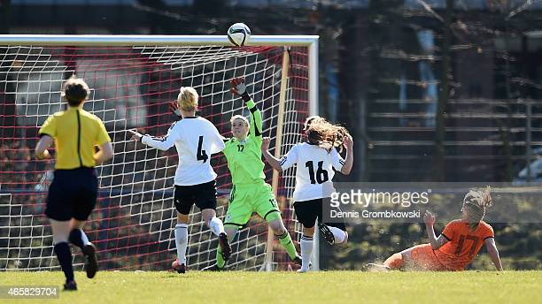 Goalkeeper Nadine Winckler of Germany saves a shot by Pien de Beer of Netherlands during the U17 Girl's International Friendly match between Germany...