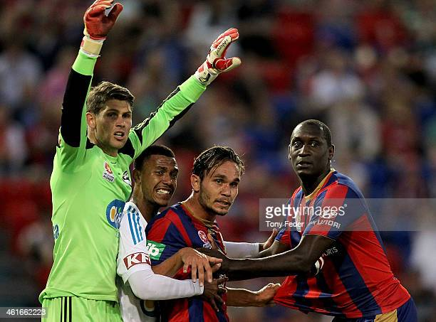 Goalkeeper Nathan Coe and Rashid Mahazi of the Victory James Brown and Emile Heskey of the Jets wait for a corner kick during the round 14 ALeague...