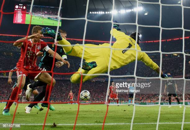 Goalkeeper Navas Keylor of Real Madrid blocks a ball against Thomas Mueller of FC Bayern Muenchen during the UEFA Champions League Semi Final First...