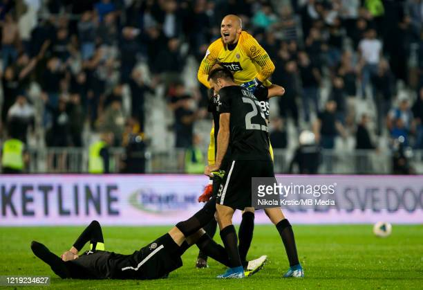 Goalkeeper Nemanja Stevanovic of Partizan Belgrade celebrates the victory with his team mates after the Semifinal Serbian Cup match between Red Star...