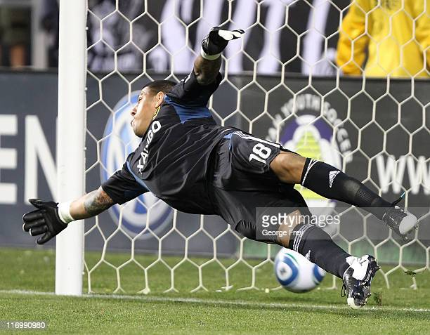 Goalkeeper Nick Rimando of Real Salt Lake fails to block a penalty kick that was called during a game against DC United late in the second half of an...