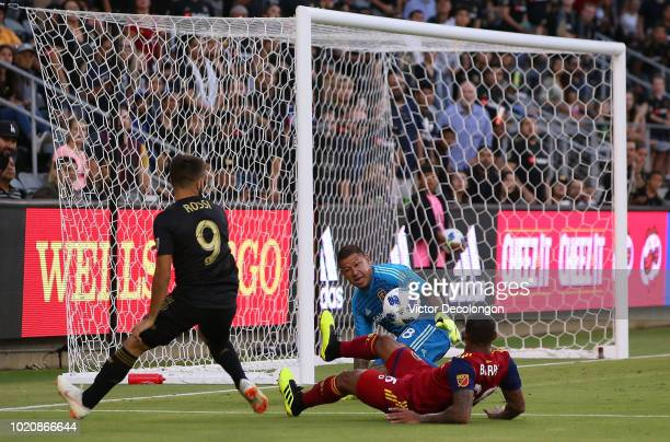 Goalkeeper Nick Rimando of Real Salt Lake makes a save on a shot by Diego Rossi of Los Angeles FC during the first half during the MLS match at Banc...