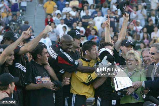 Goalkeeper Nick Rimando of the DC United kisses the MLS trophy after winning the MLS Cup 32 over the Kansas City Wizards on November 14 2004 at the...