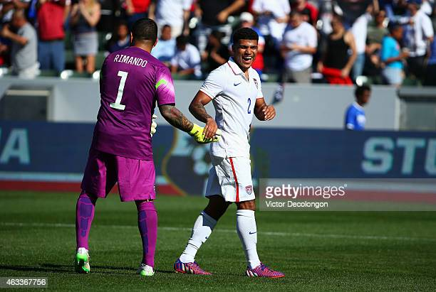 Goalkeeper Nick Rimando of the USA encourages teammate DeAndre Yedlin during half time of the international men's friendly match against Panama at...