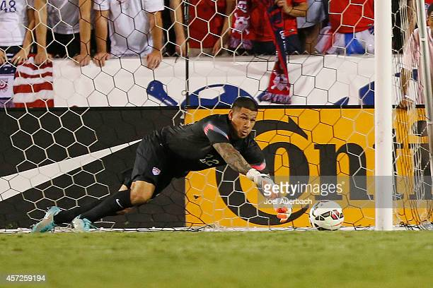 Goalkeeper Nick Rimando of the USA makes a diving save against Honduras during an International Friendly match on October 14 2014 at FAU Stadium in...