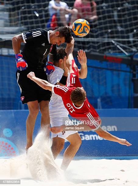 Goalkeeper Nico Stadler and Noel Ott of Switzerland defend their goal during the Men's Beach Soccer bronze medal match between Switzerland and...